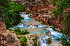Beaver Falls in Havasupai near Grand Canyon. The Havasupai website warns hikers that getting to Beaver Falls required some work, but nothing prepares you for the Stock Photography