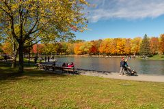 Beaver lake and foliage in autumn colors. royalty free stock images