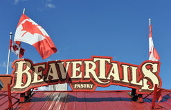 Beaver Tails sign with Canadian Flags Royalty Free Stock Images