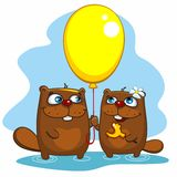 Beavers with balloon Stock Image