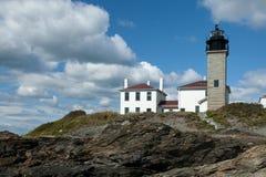 Beavertail Lighthouse Atop Rocky Coastline Stock Photo