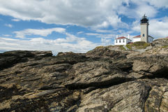Beavertail Lighthouse Over Unique Rock Formations Stock Photos
