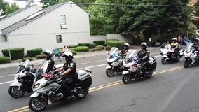 Policemen ride motorcycles in the Parade. Beaverton, Oregon/USA - September 8 2018: Policemen ride motorcycles in the Beaverton Celebration Parade stock video