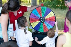 Child spinning the wheel raffle in the park royalty free stock image