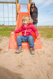 Bebé abajo de la diapositiva anaranjada Foto de archivo libre de regalías