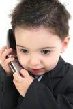Bebé adorável no terno no telemóvel imagem de stock royalty free