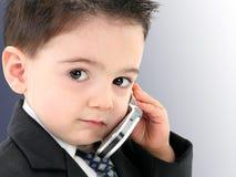 Bebé adorável no terno no telemóvel Fotografia de Stock Royalty Free