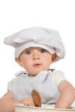 Bebé adorable en sombrero de los cocineros Fotos de archivo