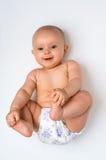 Bebé adorable que miente encendido parte posterior - aislada en blanco Foto de archivo libre de regalías