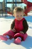 Bebé adorable que se sienta por un parque Imágenes de archivo libres de regalías