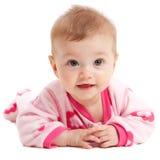Bebé aislado feliz en color de rosa Imagenes de archivo