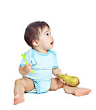 Bebé asiático con el guisante Foto de archivo libre de regalías