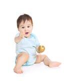 Bebé asiático con la pera Imagen de archivo