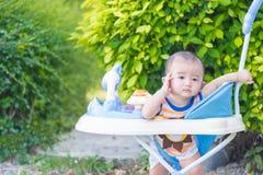 Bebé asiático en el caminante del bebé Imágenes de archivo libres de regalías