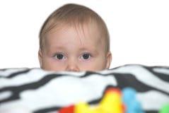 Bebé asustado y rasgón-manchado Imagen de archivo