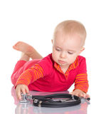 Bebê pequeno com o phonendoscope que senta-se em um fundo branco Imagem de Stock Royalty Free