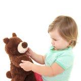 Bebé bonito com seu urso de peluche Fotos de Stock