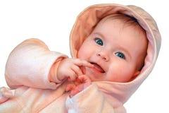 Bebé bonito no jogo cor-de-rosa com mãos Imagem de Stock