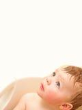 Bebé bonito que olha acima no copyspace Imagem de Stock Royalty Free