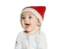 Bebé caucásico en el sombrero de la Navidad aislado Imagen de archivo