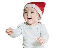 Bebé caucásico en el sombrero de la Navidad aislado Fotos de archivo libres de regalías