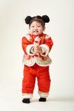 Bebé chino en equipo del Año Nuevo de chino tradicional Fotos de archivo