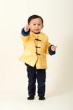 Bebé chino en equipo del Año Nuevo de chino tradicional Imágenes de archivo libres de regalías