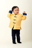 Bebé chino en equipo del Año Nuevo de chino tradicional Imagenes de archivo