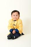 Bebé chino en equipo del Año Nuevo de chino tradicional Fotografía de archivo libre de regalías