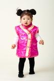 Bebé chino en equipo del Año Nuevo de chino tradicional Imagen de archivo libre de regalías