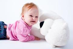 Bebé com brinquedo do urso fotos de stock