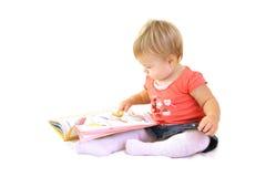 Bebé com livro Fotografia de Stock Royalty Free