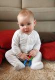 Bebé com seus primeiros brinquedos Fotografia de Stock