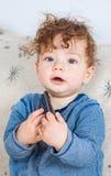Bebé com telecontrole Foto de Stock