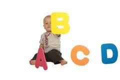 Bebé con alfabeto colorido fotografía de archivo