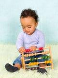 Bebé con el ábaco Imágenes de archivo libres de regalías