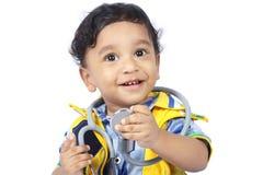 Bebé con el estetoscopio fotografía de archivo