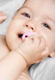 Bebé con el maniquí Imagen de archivo