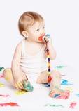 Bebé con el maniquí Fotografía de archivo