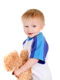 Bebé con el oso de peluche Imagen de archivo