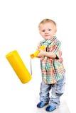 Bebé con el rodillo de pintura Imagenes de archivo