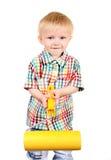 Bebé con el rodillo de pintura Imagen de archivo libre de regalías
