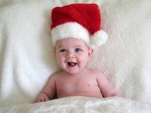 Bebé con el sombrero de santa foto de archivo