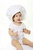 Bebé con el sombrero del cocinero Fotos de archivo libres de regalías