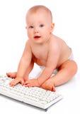 Bebé con el teclado imágenes de archivo libres de regalías