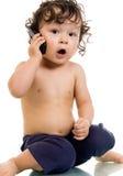 Bebé con el teléfono. Imagen de archivo libre de regalías