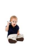 Bebé con el teléfono Fotografía de archivo libre de regalías