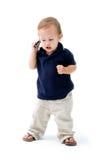 Bebé con el teléfono Foto de archivo