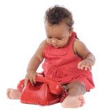 Bebé con el teléfono rojo Imagen de archivo