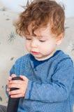 Bebé con el telecontrol Foto de archivo libre de regalías